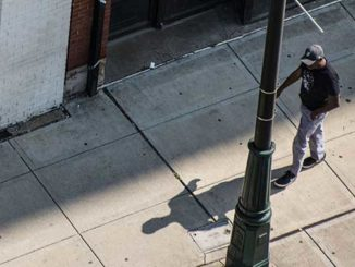 A man lose the job and walking on the street
