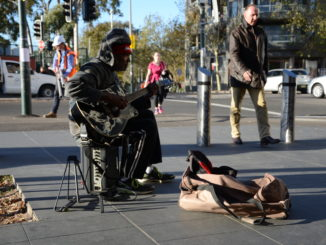 An indigenous man busking outside Redfern station