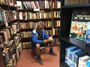 Man reading at Sappho books