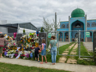Neighbours laying flowers at Imam Reza Mosque, the day after the massacre at Al Noor Mosque in Christcurch, New Zealand, CC. By Nick.