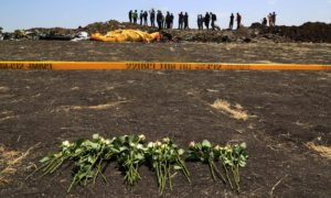 Flowers at the scene of the crash in Bishoftu, Ethiopia. Photograph: Wang Xi/China News Service/VCG/Getty Images
