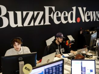 BuzzFeed News employees behind computers