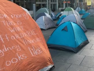"A protest sign at the Martin Place homeless camp from 2017 which says, ""For many this is what affordable Sydney housing looks like""."