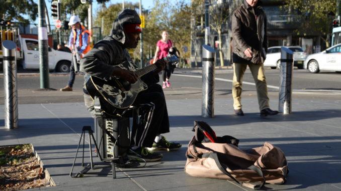 An indigenous man busking outside Redfern station
