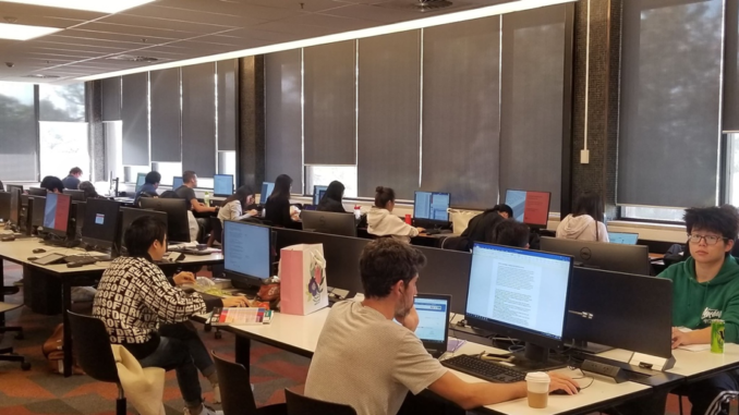 A large number of international students can be found studying hard in the university library.
