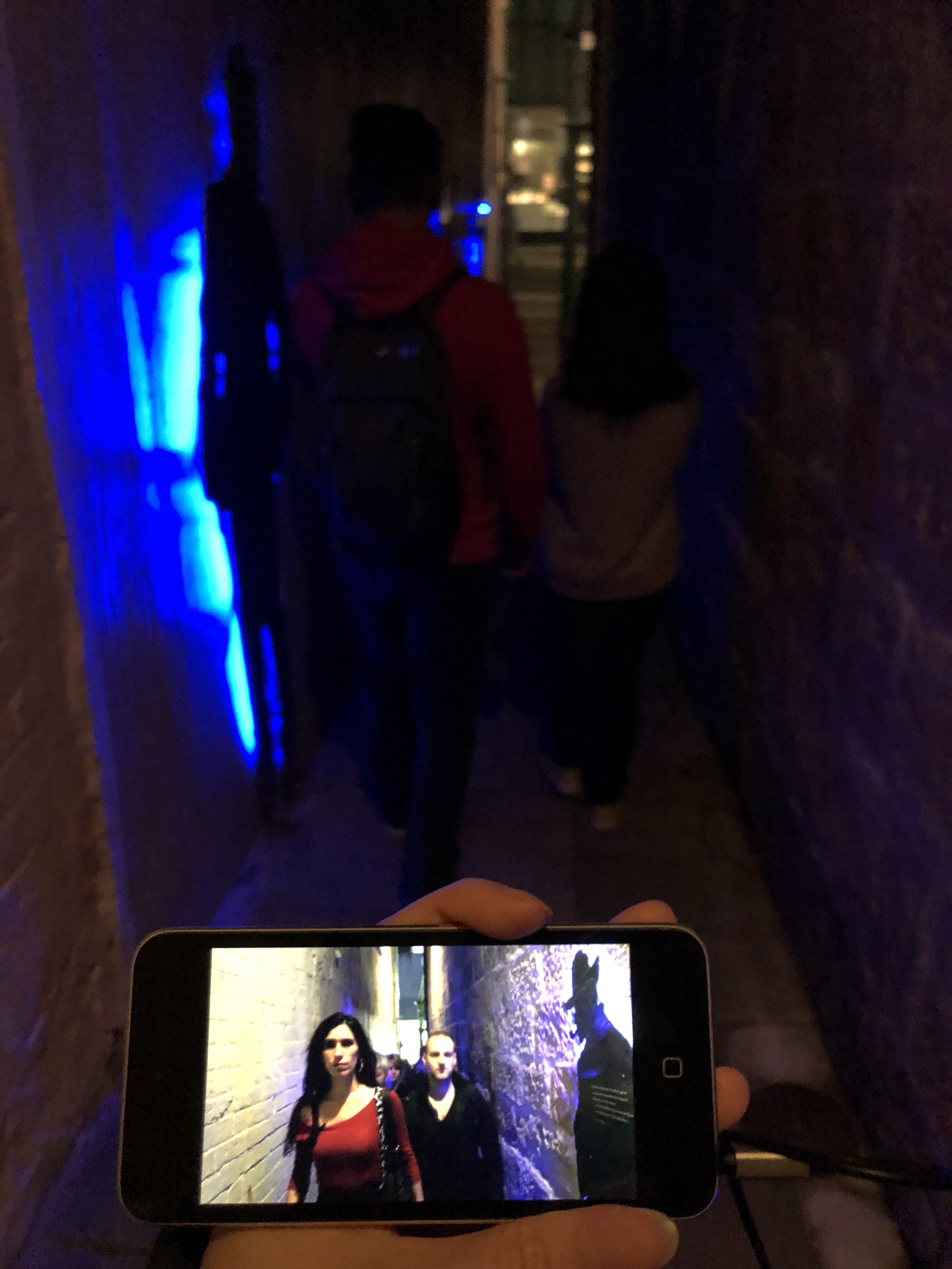 Alleyway shows people walking coldly in isolation in modern world in the video against the background of history