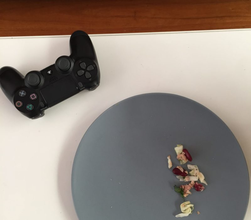Playstation controller and plate with leftover lunch