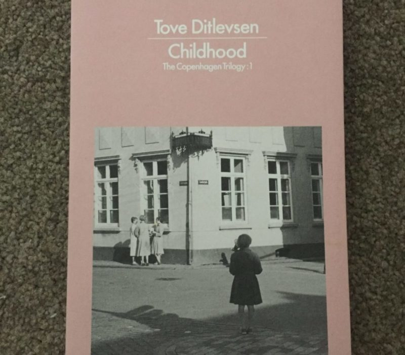 A pink book by Tove Ditlevsen, called Childhood