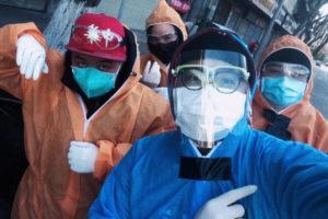 A selfie of team members wearing protective cloth