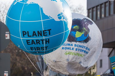 Greenpeace organisation raises big balloons with Planet Earth first message on it