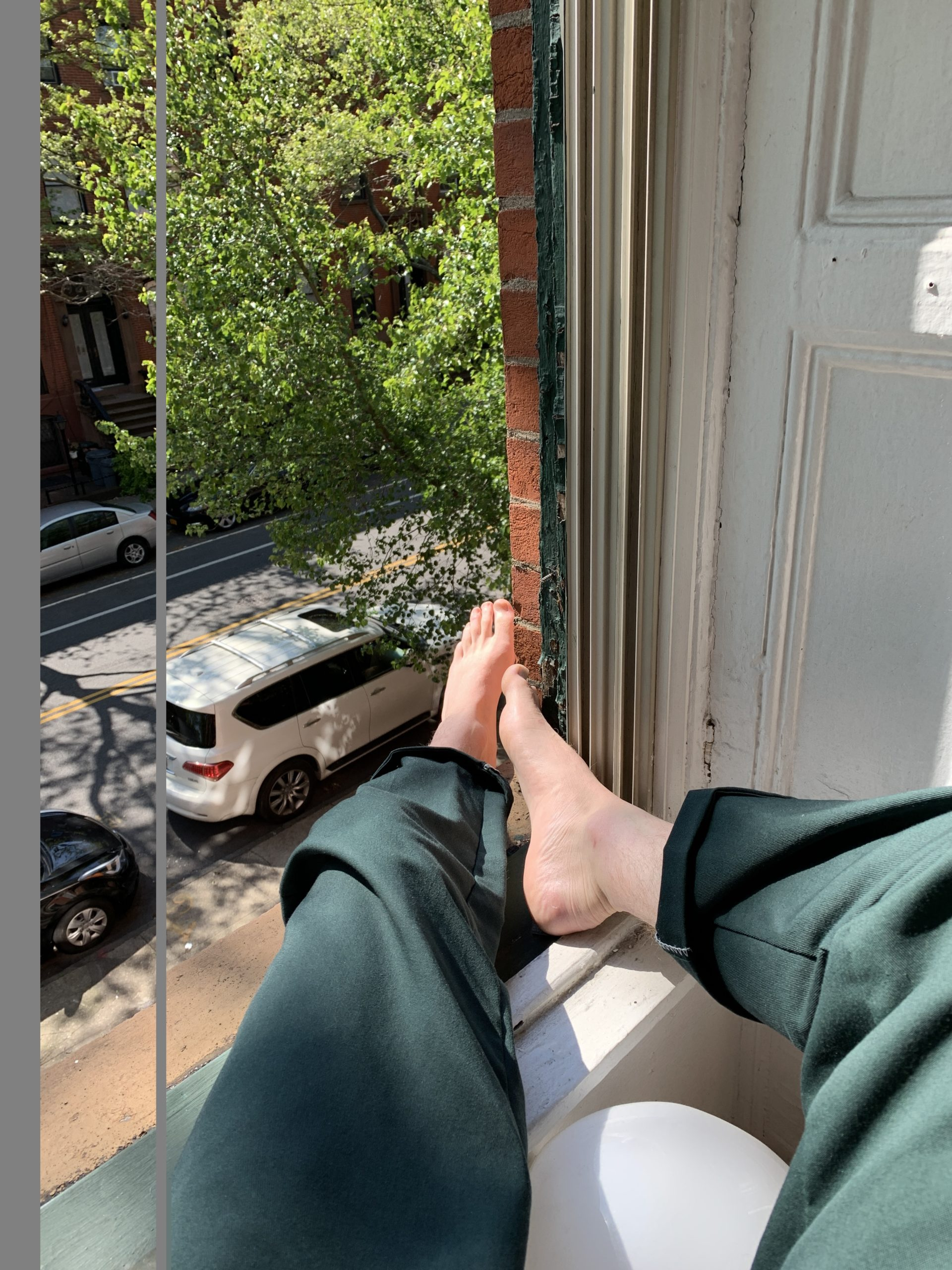 Man sitting on a window sill