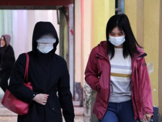 People wearing face masks to protect from coronavirus (Covid-19) in Macau, China